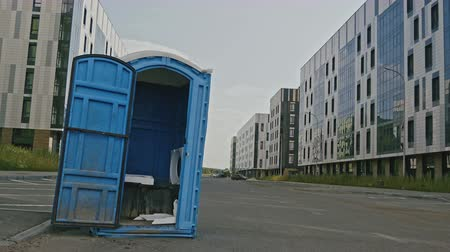 septic : Blue public toilet at empty street of innopolis city, close up Stock Footage