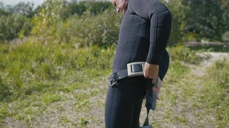 spearfishing : Spear underwater fisherman wearing belt with weights, preparing for hunt