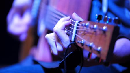 barmetro : Musician in night club guitarist plays acoustic guitar, extremely close up