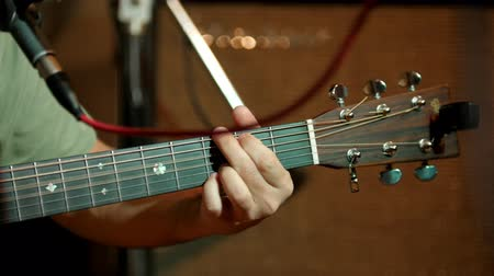 headstock : Musician playing acoustic guitar - guitar soundboard, telephoto