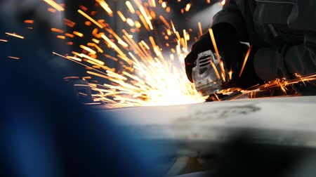 metal worker : Car service - worker grinding metal construction with a circular saw