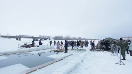 christening : KAZAN, RUSSIA - JANUARY 19, 2017: Jesus Christs baptism holiday on kazanka river. Traditional winter bathing in center of city