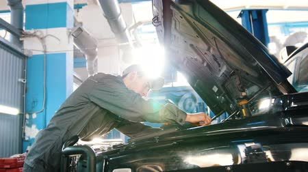 toolbox : Mechanic in car service - repairing in engine compartment - slider shot