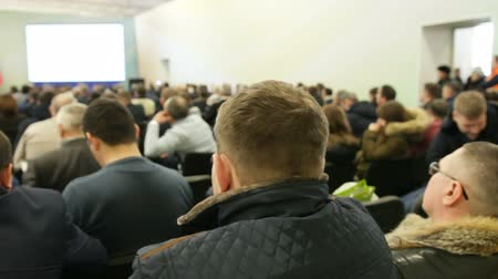 лекция : Lecturer shows presentation on screen for listeners at agricultural seminar Стоковые видеозаписи
