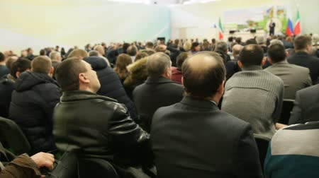 лекция : People at conference - adult men sitting in hall and looking to lecture