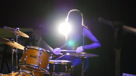 musical intrument : Girl drummer, attractive young woman plays the drums