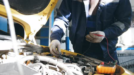 toolbox : Mechanic in auto service - repairing electricity compartment for yellow sport car