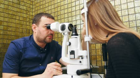 sighted : Patient in optometrists room - ophthalmology doctor - checking females Eyesight
