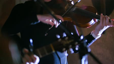 mozart : Rock band - Woman playing the violin at rock concert Stock Footage
