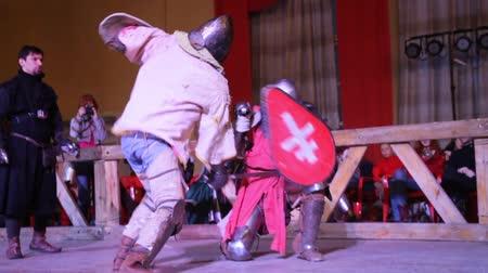 knightly : Kazan, RUSSIA - February 18, 2017: knights fell to the arena, Championship in Historical Medieval Battle HMB - Donjon Cup Stock Footage