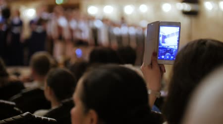 choral : Spectators at concert - people shooting performance on smartphone, music opera