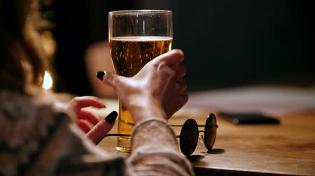 bares : Story in bar - woman drink beer and talking with friend, black glasses on bar counter Vídeos