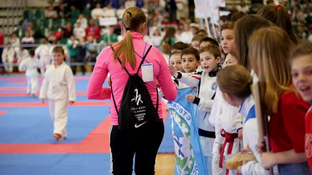 quimono : Kazan, Russia, 8 april 2017, Palace of single combats Ak Bars Kids karate competition WKF - athletes give the Tatar national delicacy chak-chak