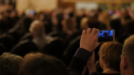 choral : Auditorium at concert - people shooting performance on smartphone, music opera Stock Footage