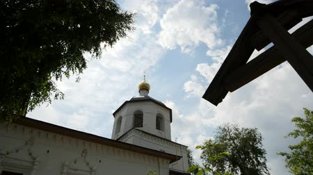 vasárnap : Wooden orthodox Cross and dome of church - slider shot