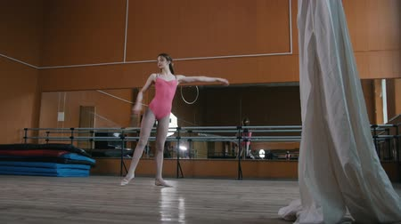 tightrope : Girl gymnast is dancing with whip - perform circus exercise - video with sound