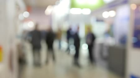 People on big exhibition - blurred background