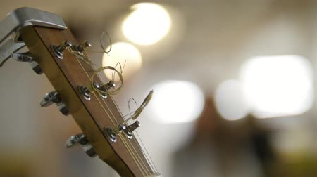 headstock : Saundboard of acoustic guitar - instrument on stage Stock Footage