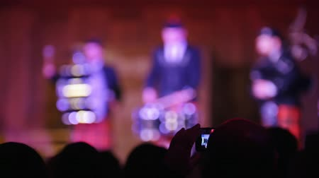 choral : Spectators at concert - people shooting performance on smartphone, scottish musicians Stock Footage