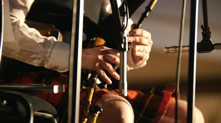 felvidéki : Bagpipe player in a kilt plays musical instrument at the stage