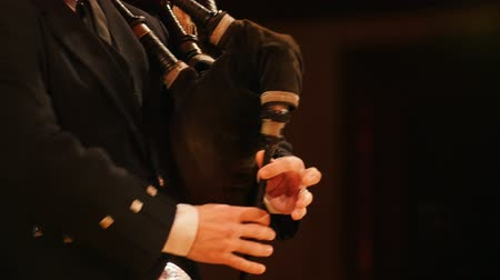 felvidéki : Bagpipe player plays musical instrument at the stage
