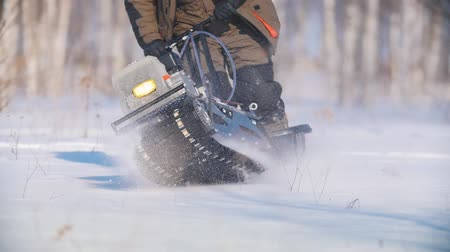 permeability : Mini snowmobile overcoming, manoeuvring and turning deep snow Stock Footage