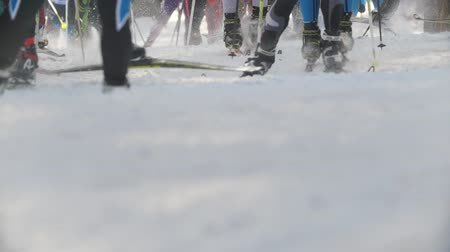 deslizamento : KAZAN, RUSSIA - March, 2018: start of the ski race, close-up of skis and legs of a large number of participants