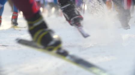 deslizamento : KAZAN, RUSSIA - March, 2018: slow motion close-up of professional skiers  feet, the snow flying from under the skis