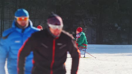 paralympic : KAZAN, RUSSIA - March, 2018: two skier Paralympic athlete before the start of the ski marathon, skiers ride around them