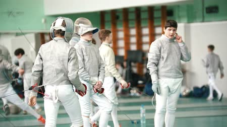 meç : KAZAN, RUSSIA - 26 MARCH, 2018: Young fencers fighting on the fencing tournament