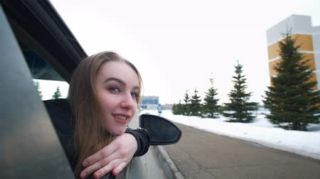 admirado : Happy woman leans in the car window admired the journey Stock Footage