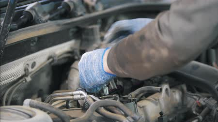 tread : Mechanic man in gloves repairing auto parts at the service station Stock Footage