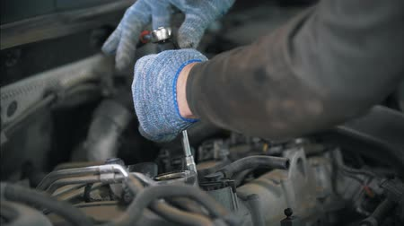 tread : Man worker in gloves working with wrench on the car Stock Footage