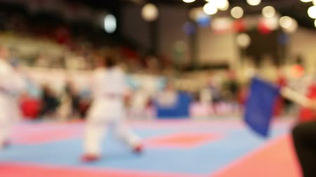 каратэ : Two teenagers fighting at the karate championship - blurred Стоковые видеозаписи