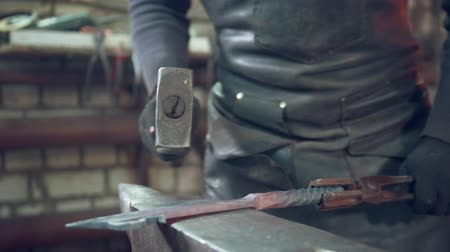hot rod : Craftsman blacksmith with hammer in forge creating steel things