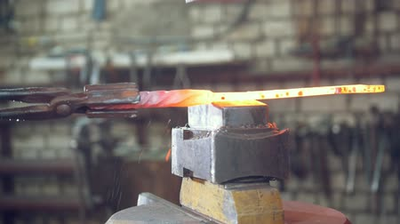 hot rod : Blacksmithing forging on an anvil in the forge