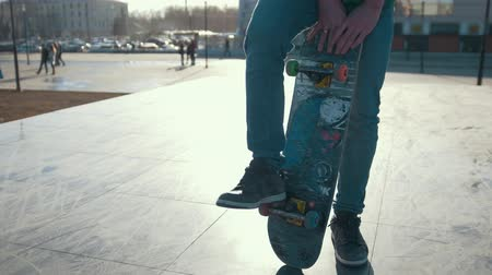 kickflip : Young man on his skateboard outdoors in sunny day Stock Footage