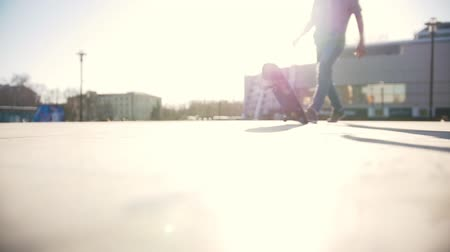 кроссовки : Skateboarder riding on his board on the street in sunny day