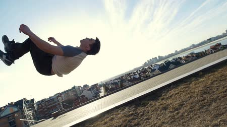 backflip : Urban acrobatics - teenager performing somersault outdoor