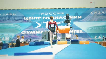 handstand : KAZAN, RUSSIA - APRIL 19, 2018: All-Russian gymnastics championship -Young woman gymnast runs up to jump Stock Footage