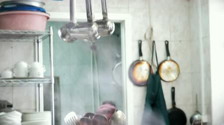 mutfak malzemesi : Utensils hanging on holder in a pair at the restaurant kitchen