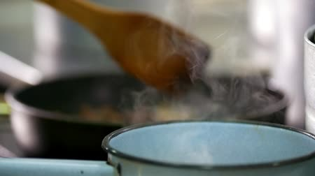 kitchenware : Chef mixes food in front of steam boiler Stock Footage