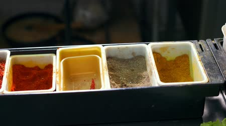 koriander : Set of spices in boxes in a restaurant kitchen