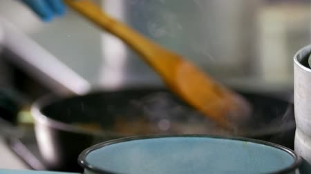 wok : Chopped mushrooms and meat fried in vegetable oil in the pan Stock Footage