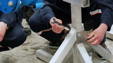 post and beam construction : Workers on installation work of metal construction