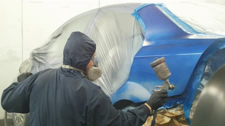 spraying : Professional car painter in vehicle workshop