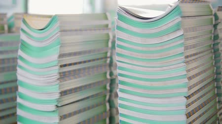 nakladatelství : Stacks of folded printed editions on the table