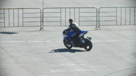 autobike : A man riding a blue motorcycle, slow-motion Stock Footage