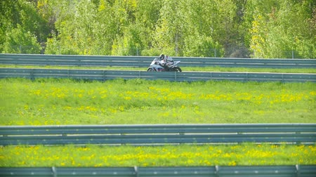 autobike : Motorcyclist rides on a curved track Stock Footage