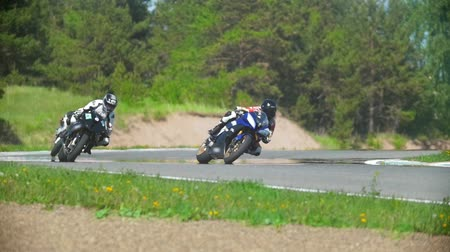 autobike : Alot of motorcyclists on the race track, slow-motion